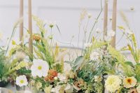 10 The wedding tablescape was done with bright and neutral blooms, pastel candles and grey porcelain
