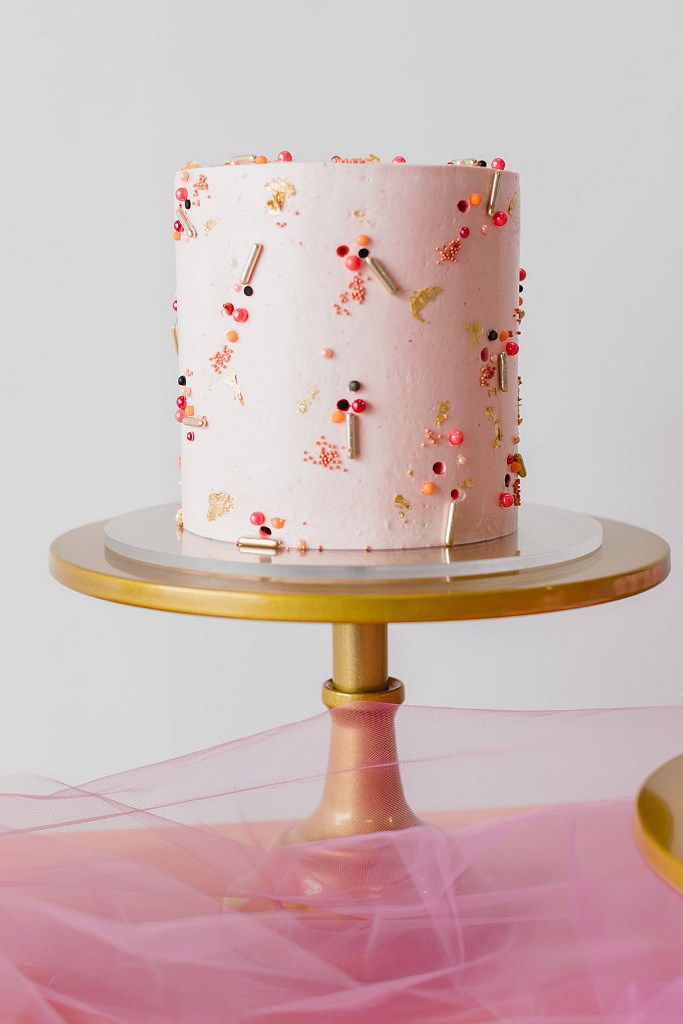 The wedding cake was a pink one, decorated with bold beads and glitter for a fun feel