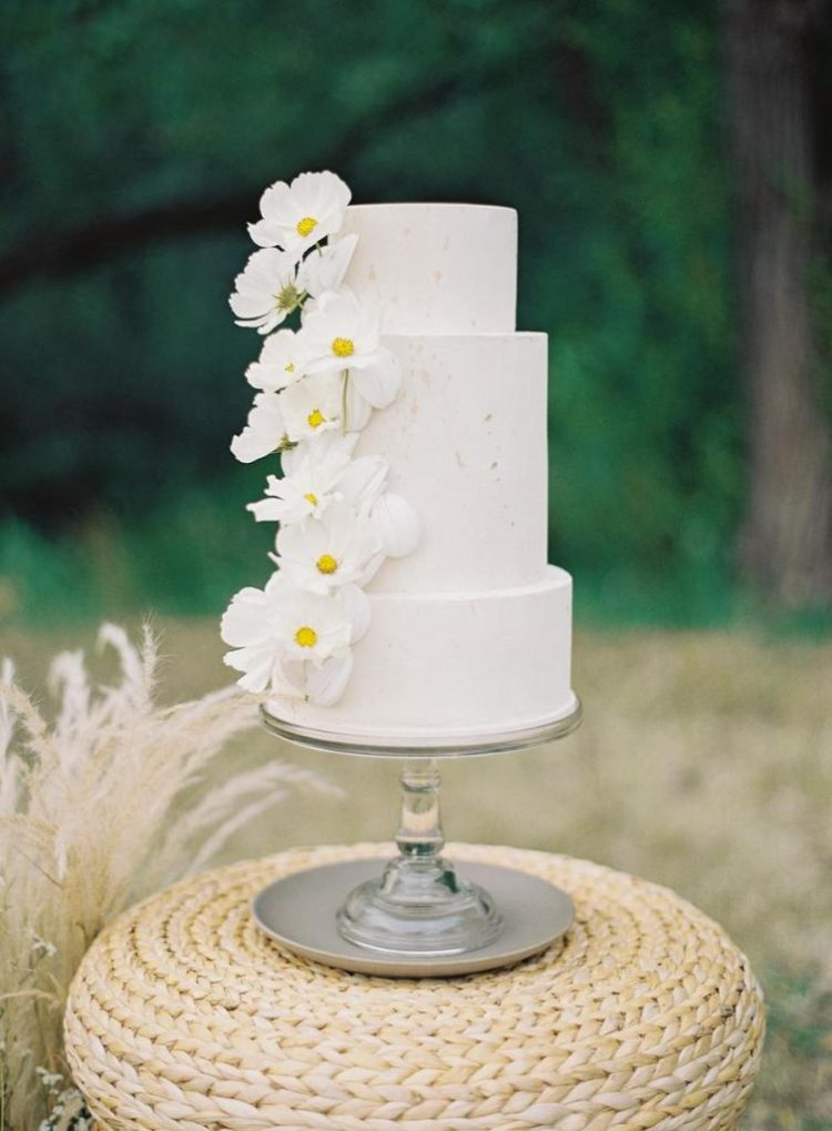 The wedding cake was a white textural one, with white fresh blooms for decor