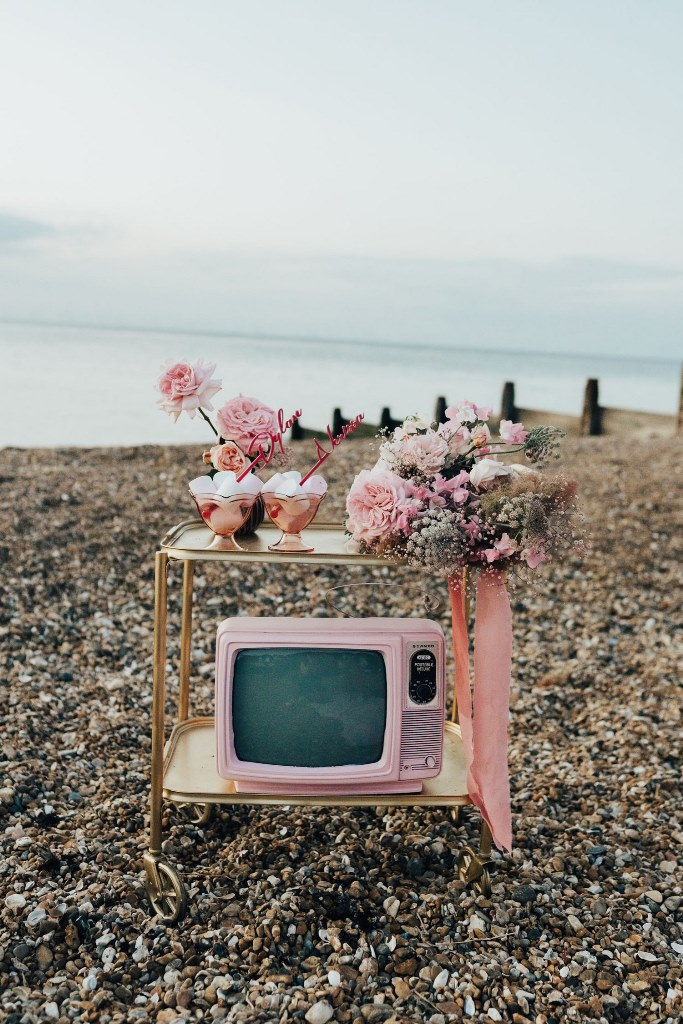 a stylish wedding dessert table with a tv