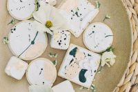 12 An assortment of dreamy watercolor cookies completed the wedding dessert table
