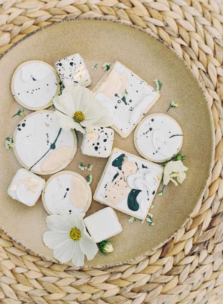 An assortment of dreamy watercolor cookies completed the wedding dessert table