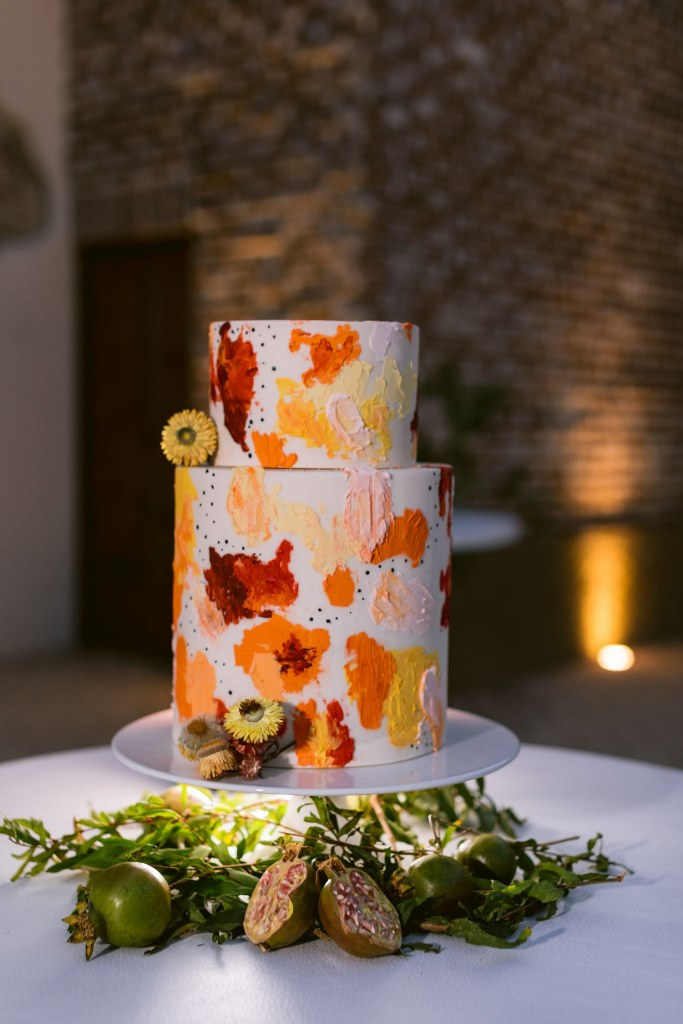 The wedding cake was done with bright splashes and dried blooms to continue with a war color palette
