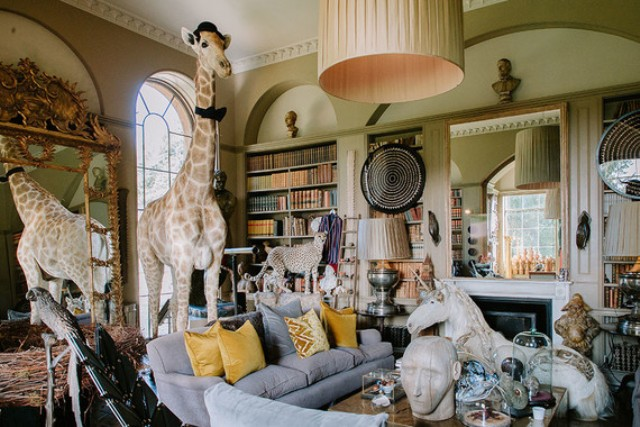 What a gorgeous wedding lounge with whimsical figurines