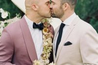 13 One of the grooms was wearing gorgeous fresh flower detailing on his tux