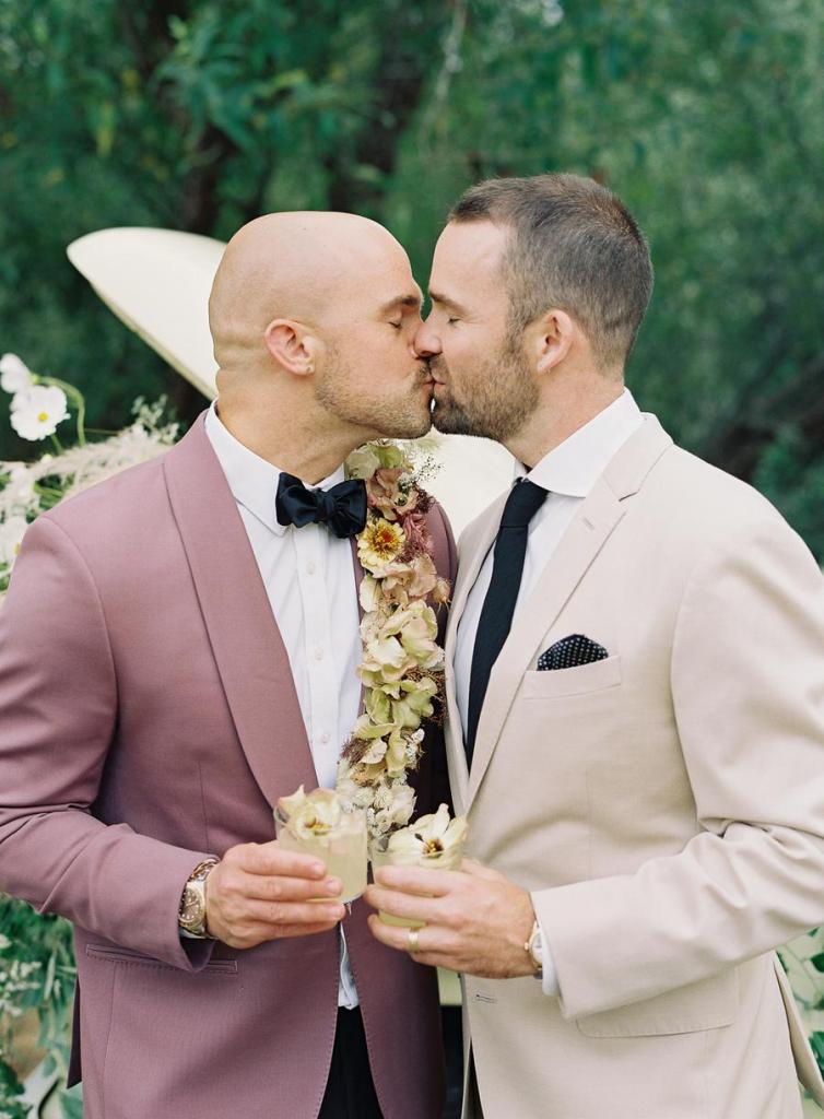 One of the grooms was wearing gorgeous fresh flower detailing on his tux
