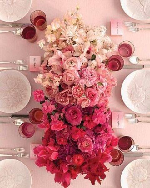 a chic ombre wedding centerpiece from white to light pink, hot pink and red is a very beautiful wedding decor idea