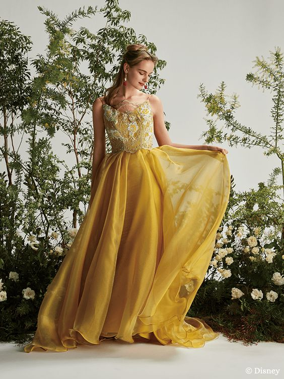 a Disney inspired wedding dress with an embroidered floral bodice, a pleated layered skirt and spaghetti straps is wow