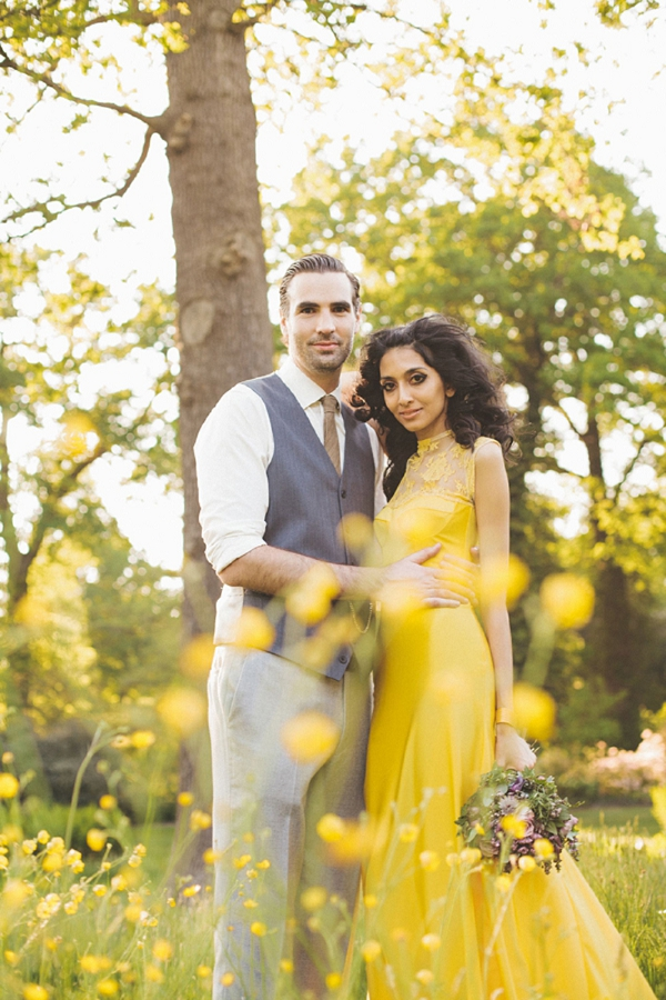 a bright yellow mermaid wedding dress with a lace neckline and a train is a beautiful idea for a bright garden wedding