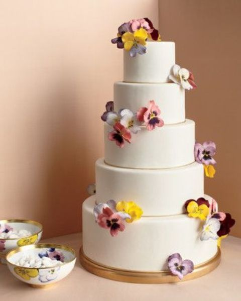 a chic five-tier wedding cake decorated with bright blooms is a lovely and bold idea for any wedding