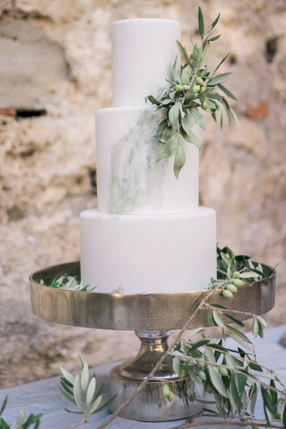 a chic three-tier wedding cake with green watercolors, greenery and olives is a fantastic idea for a Greek or Tuscany wedding