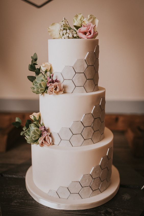 a modern wedding cake with geometric details