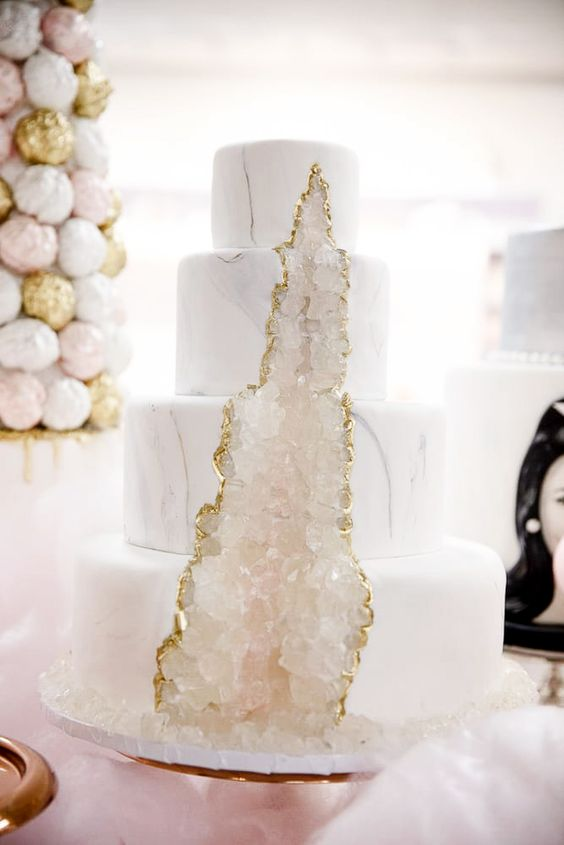 a chic white marble wedding cake with crystals and a gold edge is a beautiful and fantastic idea for a modern glam wedding