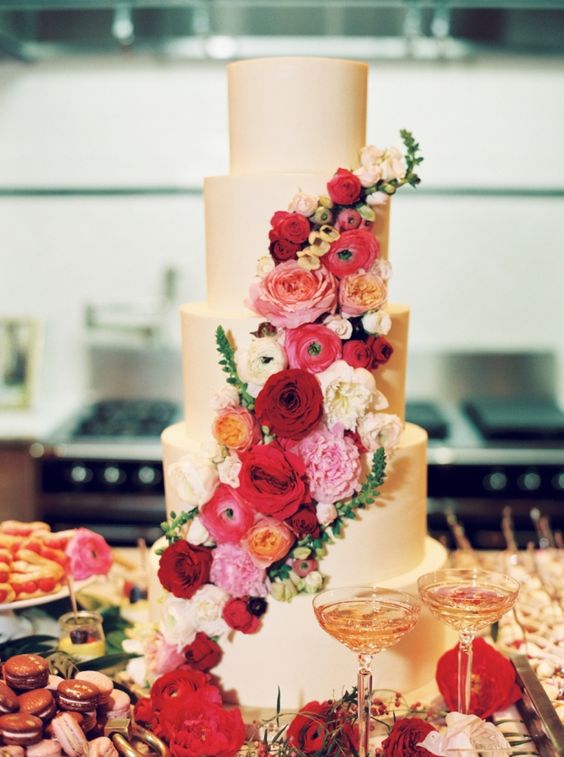 a fantastic plain five tier wedding cake with bold red, burgundy, pink and neutral blooms is a beautiful statement to make
