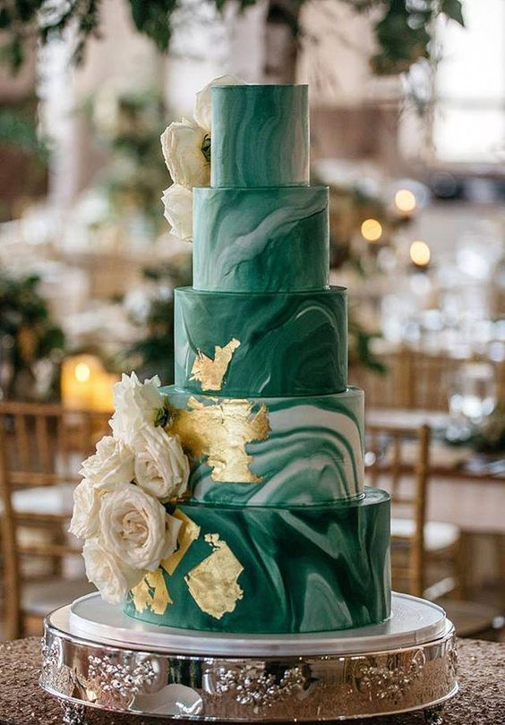 a green marble five tier wedding cake with gold leaf and fresh neutral blooms is a very chic and beautiful idea