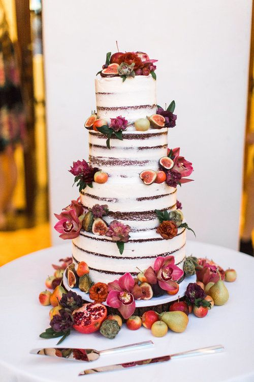 a lovely four tier naked wedding cake with bold blooms, fruits and berries will be a nice idea for a fall wedding with a farmhouse or other theme