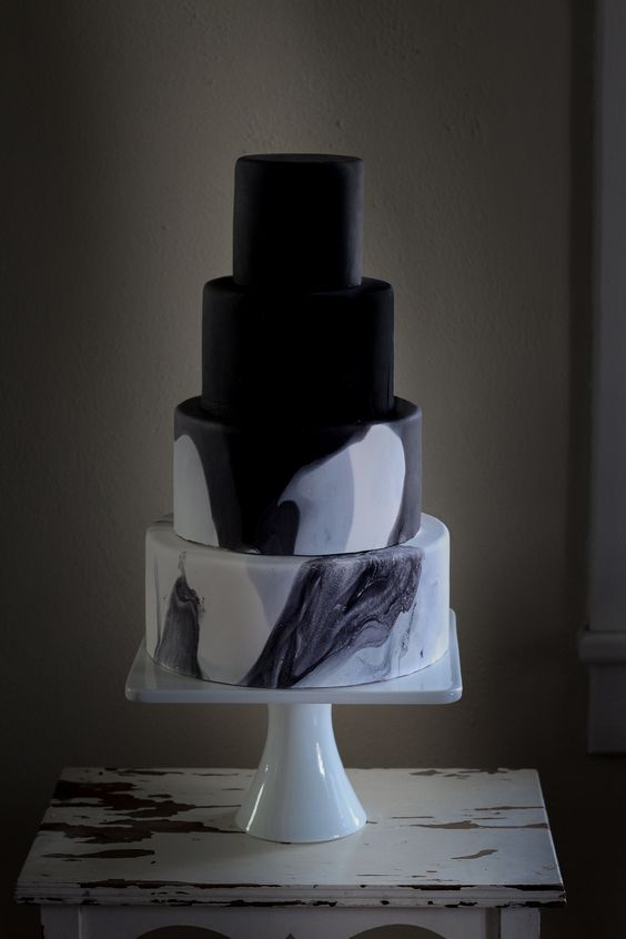 a minimalist four tier wedding black with black and marble tiers is a very statement-like and bold idea