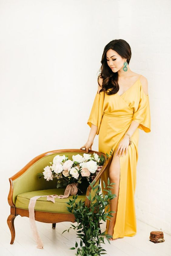 a modern and elegant yellow silk cold shoulder wrap wedding dress is a gorgeous idea for a color-loving bride