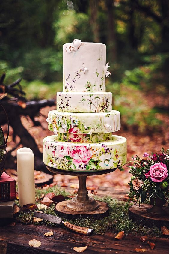 a quirky five tier floral wedding cake that shows off beautiful painting and some sugar blooms is amazing and adorable