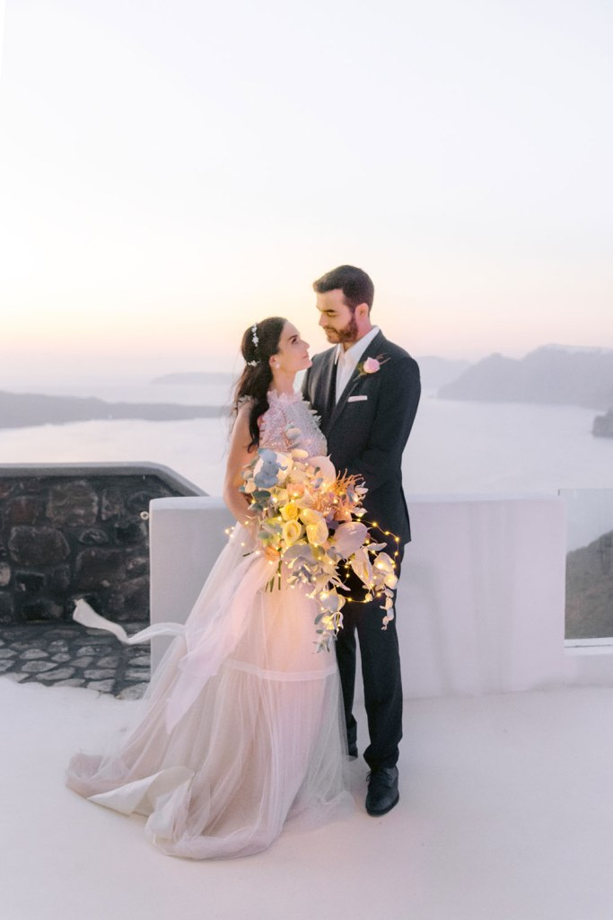 This couple went for a pink Santorini elopement and enjoyed the amazing views and candy pink touches