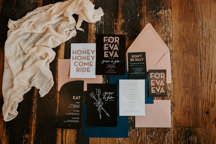 The wedding stationery was done in black, blush and navy, with cool modern prints and fun