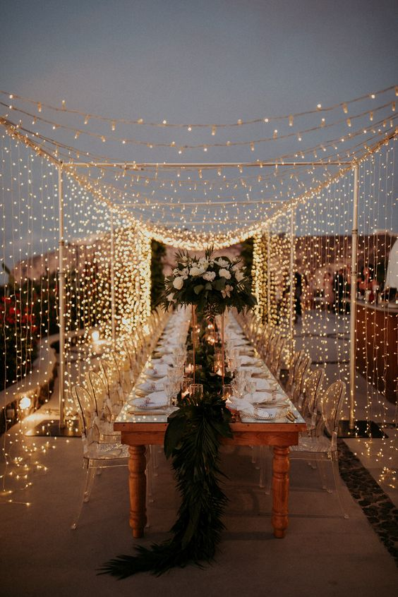 a magical outdoor wedding reception space with a light canopy is a gorgeous idea for a wedding during COVID due to restrictions