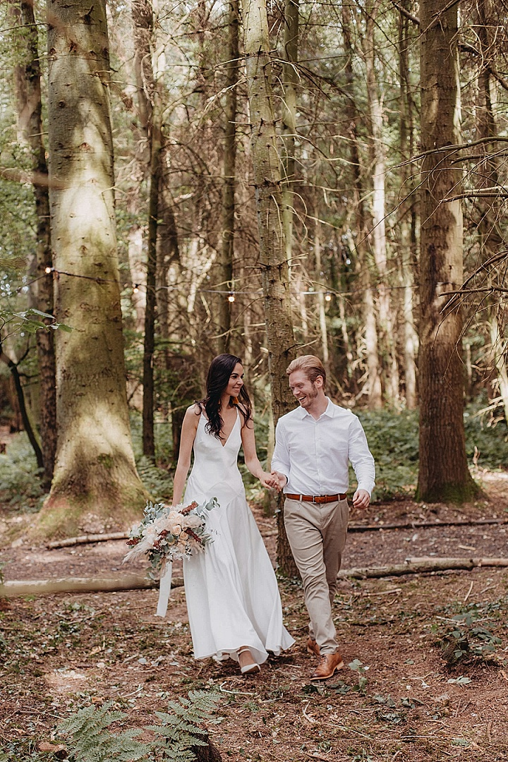 The bride was wearing a plain slip wedding dress, the groom was rocking a white shirt, grey pants and brown shoes