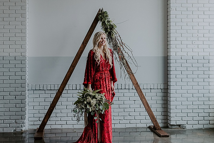 The wedding arch was a triangle one, with twigs and greenery, and the wedding bouquet was mostly of greenery