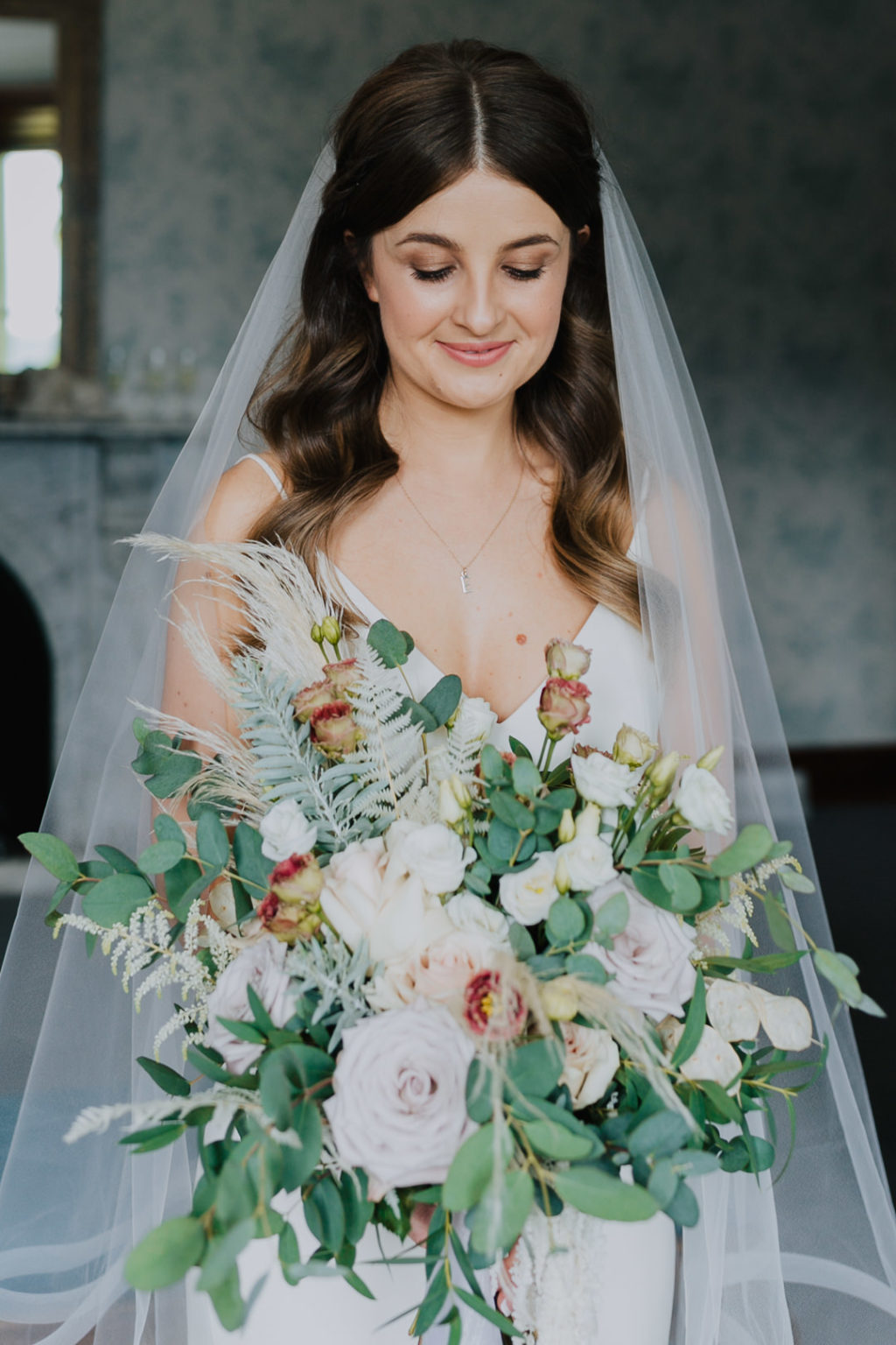 The wedding bouquet was done with pastel and white blooms and much greenery
