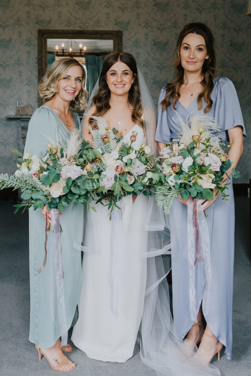 The bridesmaids were wearing pastel wrap maxi dresses and nude shoes