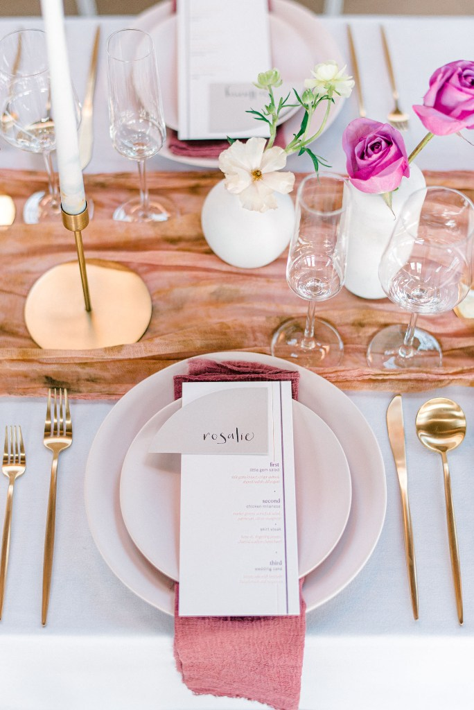 The reception table was done with a dip dyed fabric runner, mauve napkins, bold blooms and gold touches and looked fresh and elegant