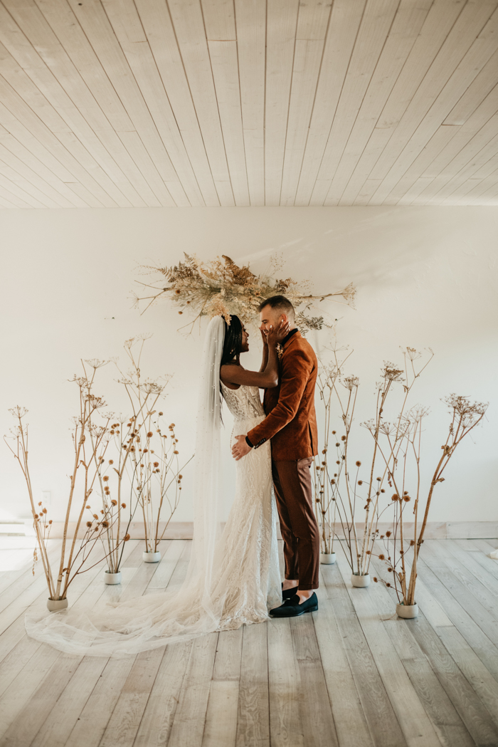 The wedding altar was done with dried blooms and branches and a fantastic overhead installation with dried leaves and grasses