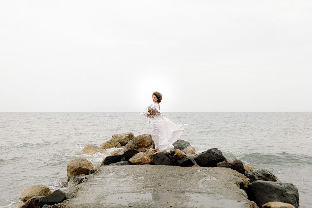 The wedding ceremony backdrop was the sea itself