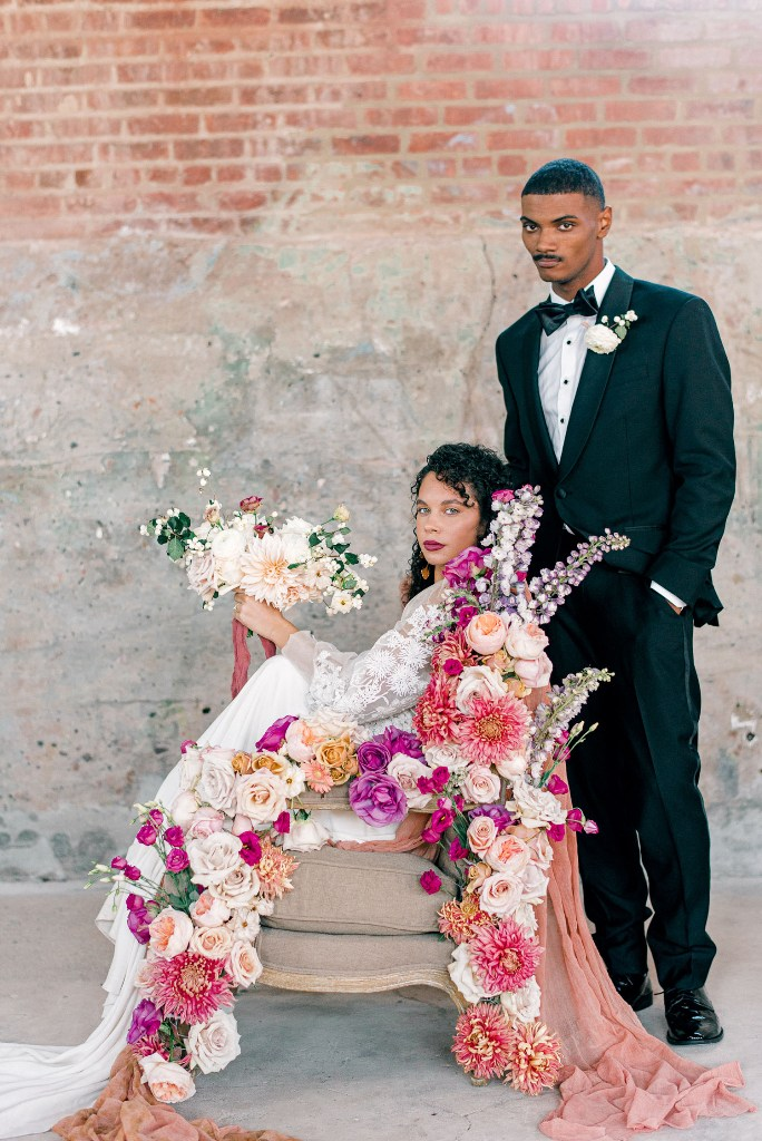 A chair was decorated in a jaw-dropping way, with the same bold blooms and fabric, and the wedding bouquet was blush