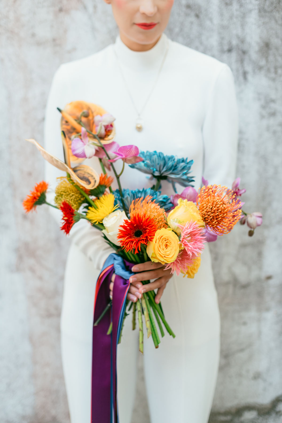 Her wedding bouquet was extra colorful, with blooms of all the colors of the rainbow