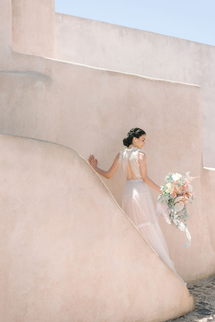 The dress was cutout on the back, and the wedding bouquet was done in blush shades