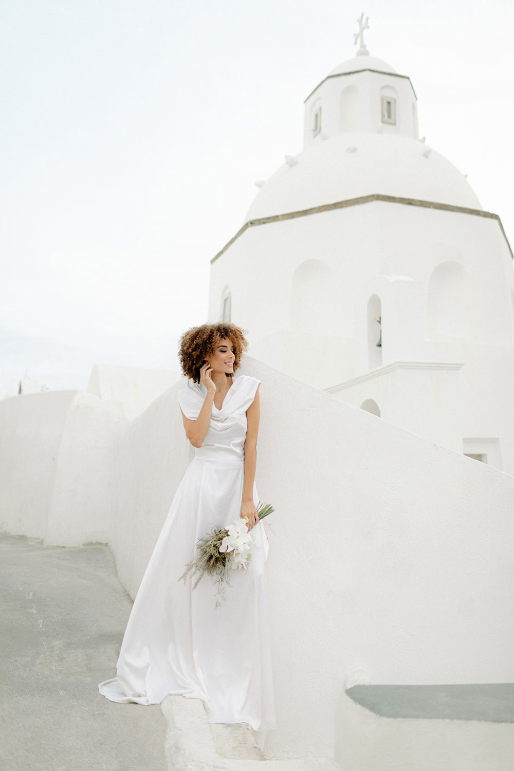 The second wedding dress was a plain one with a cowl neckline and a train, it looked minimalist and very chic