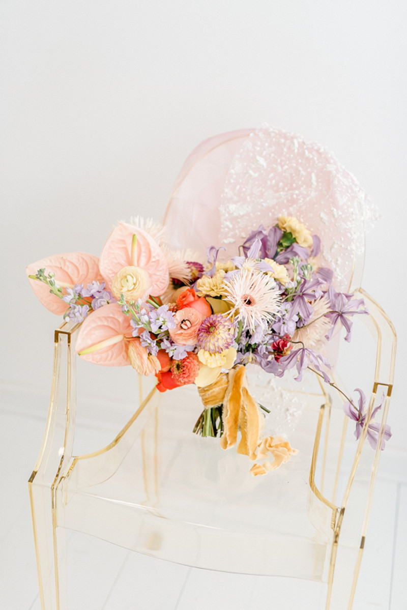 The wedding bouquet was a pastel one, with pastel ribbons and no greenery