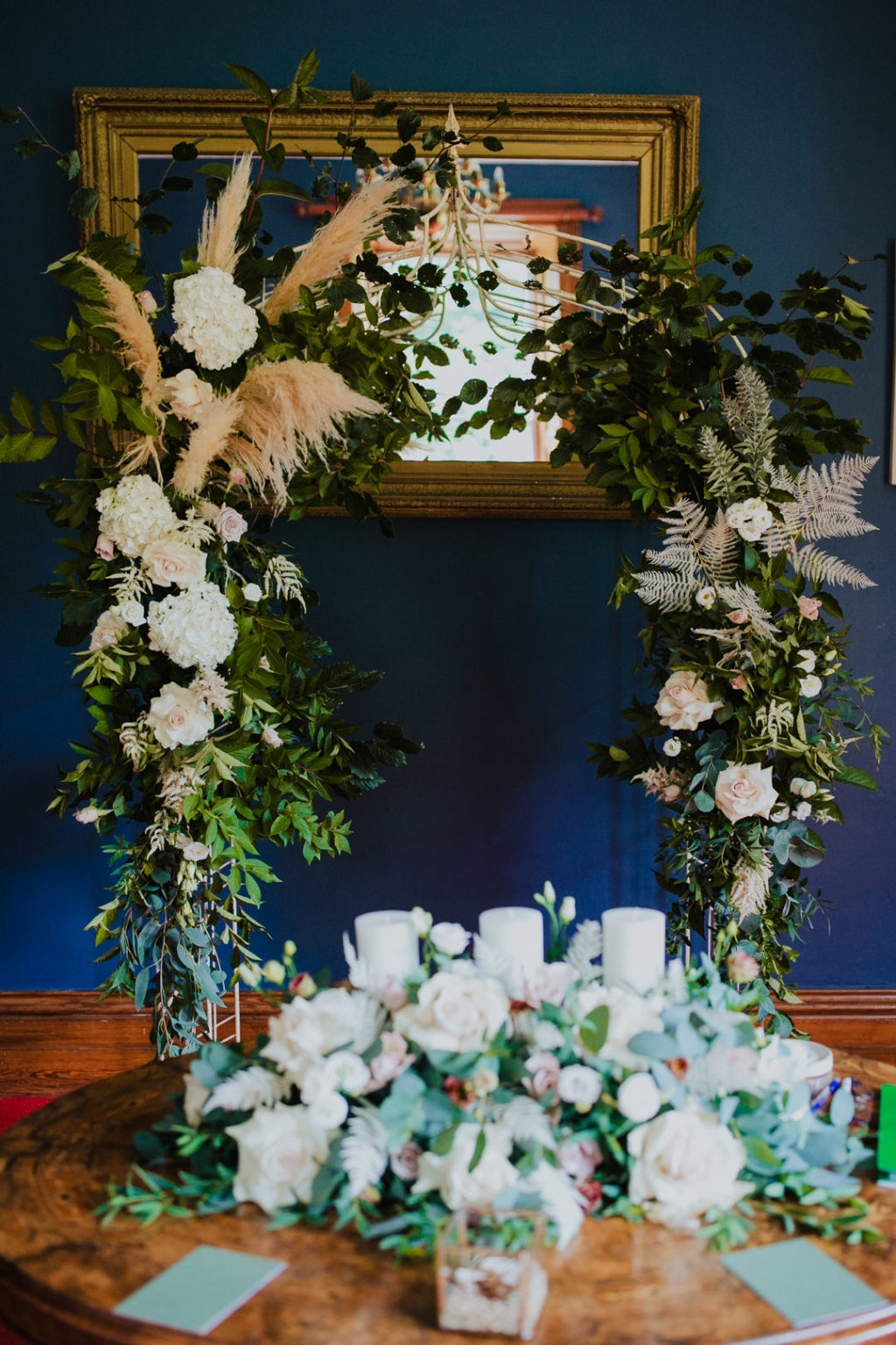 The wedding arch was of greenery, pampas grass and white and blush blooms