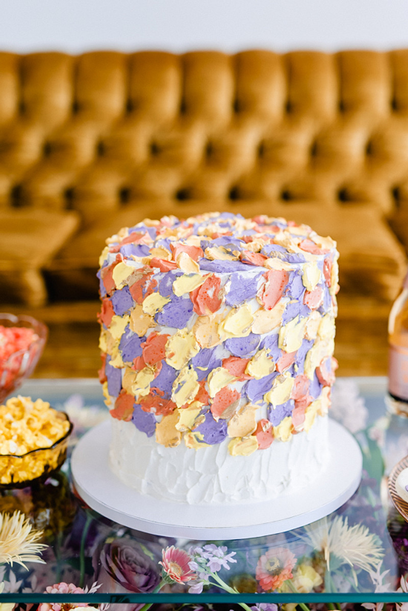 The wedding cake was a colorful watercolor one to match the color palette