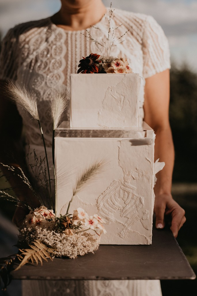 The wedding cake was a square one, with botanical prints and blooms on top