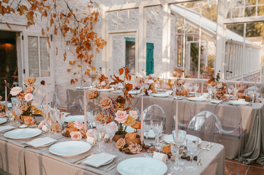 The reception tables were decorated in the same soft fall shades, with grey tablecloths, blush candles and there were acrylic chairs