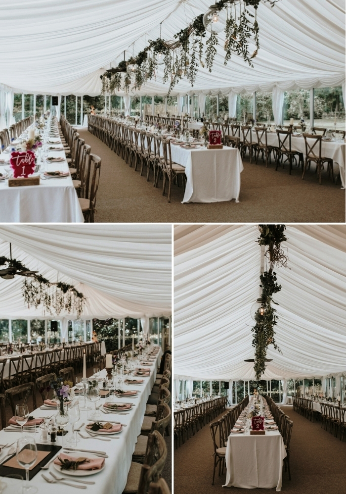 The wedding reception space was done with a white curtain, greenery and bulbs nd some simple floral decor
