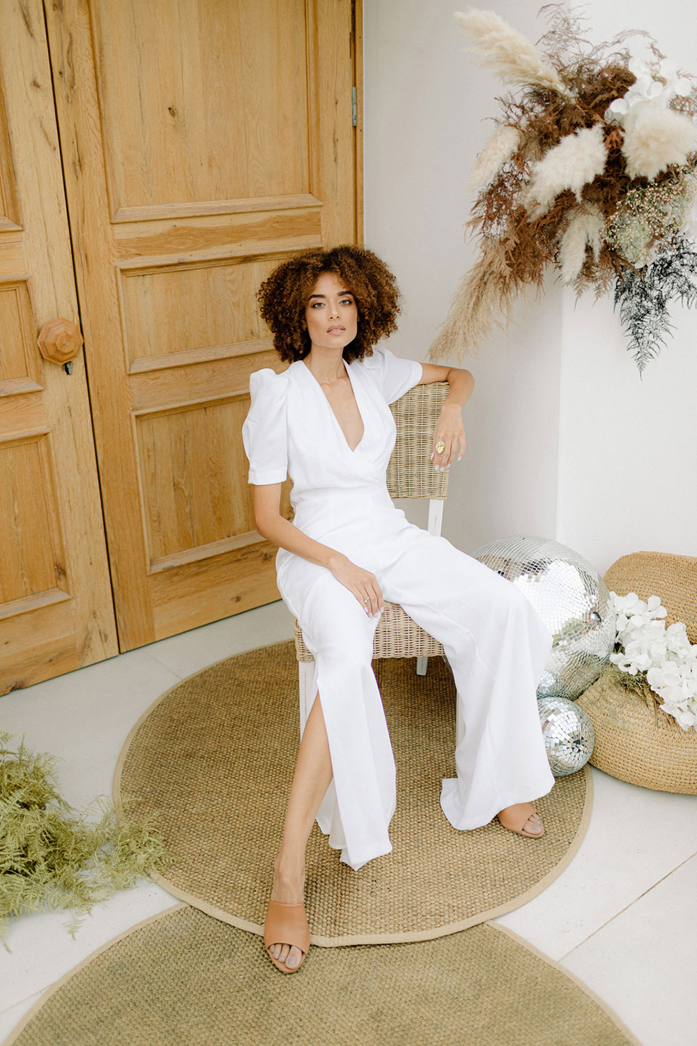 The third bridal look was done with a white plain jumpsuit with short sleeves and slit cropped pants