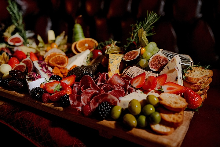 There was a lovely wedding cheese board with fruits, berries and charcuterie