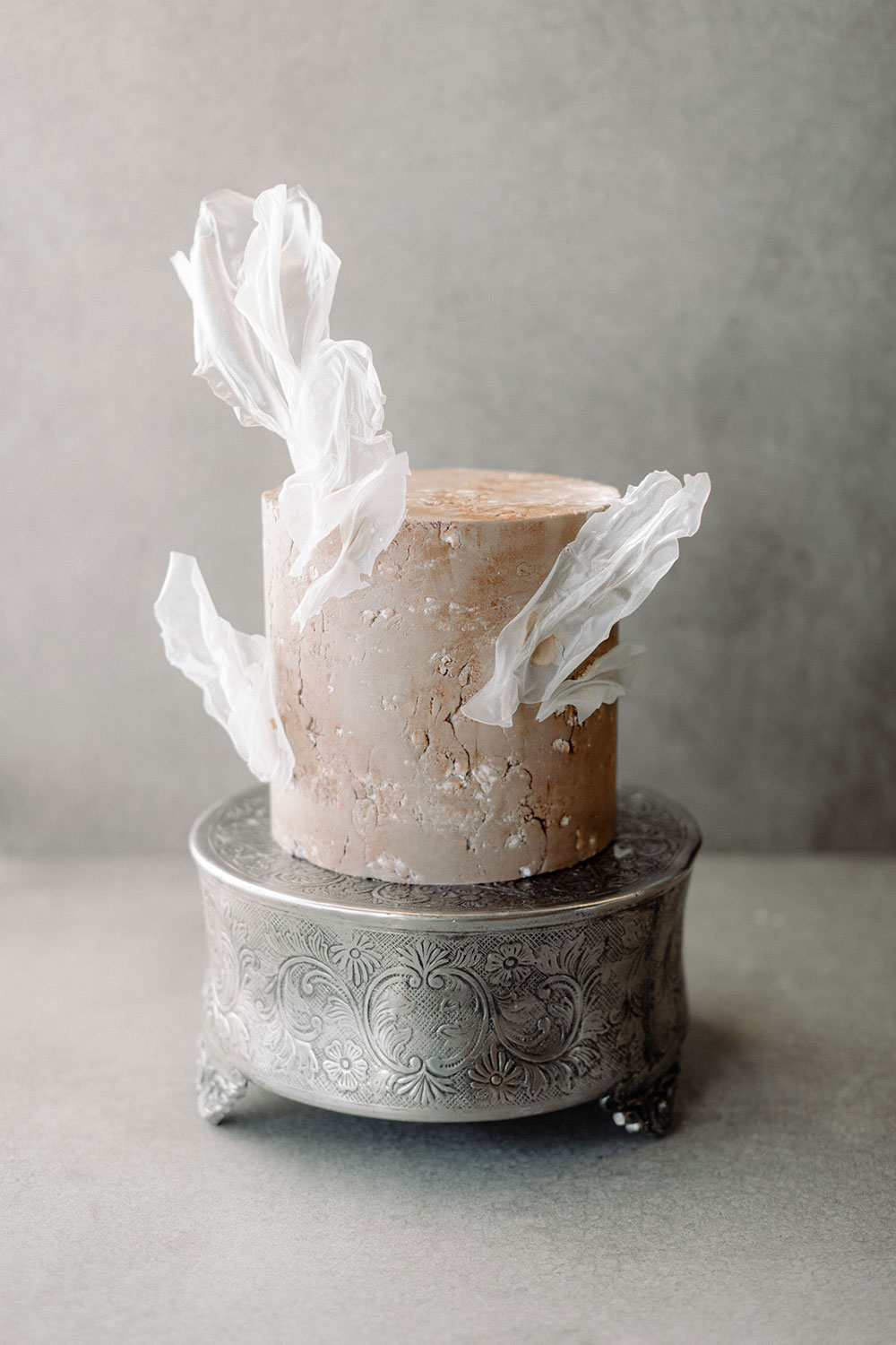 The wedding cake was done with texture, in rust shades with a white sugar pieces floating over the cake