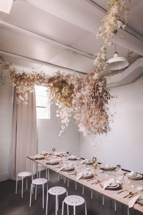 a dreamy blush dried bloom overhead installation is a gorgeous decor idea for a wedding