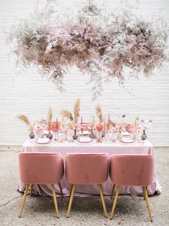 an airy and ethereal blush and silver dried leaf overhead installation makes a lovely statement in the space