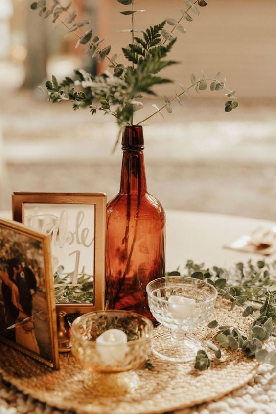 use bottles, photos, chargers, candle holders you have at home to decorate your wedding venue