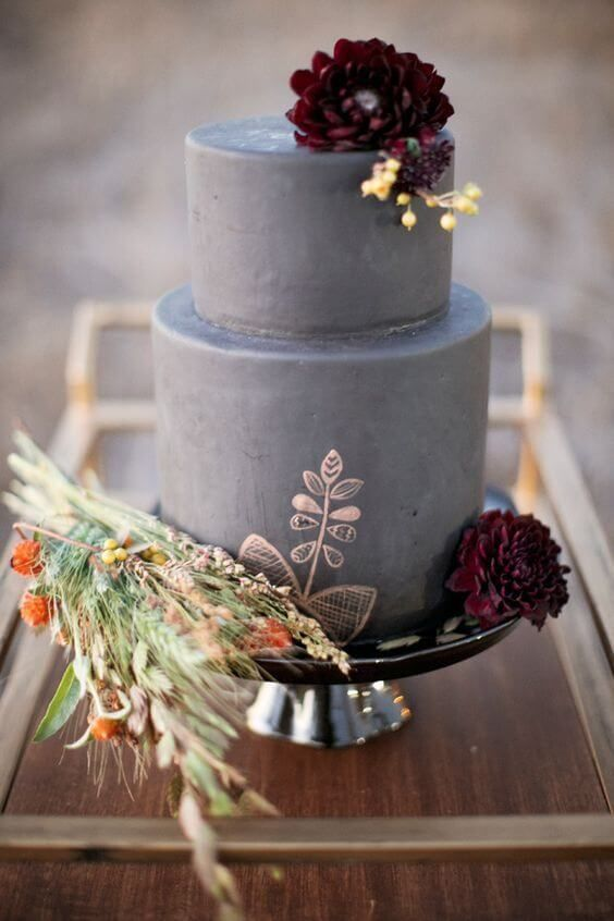 a grey concrete wedding cake with copper painting, burgundy blooms and grasses is a stylish idea for a modern fall wedding